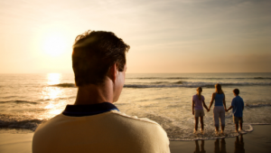 man watching family sunset
